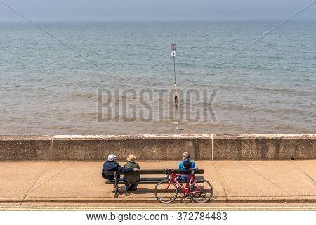 Hunstanton, Norforlk/ United Kingdom- 14 June 2020: Old People Observing Social Distancing On The Se