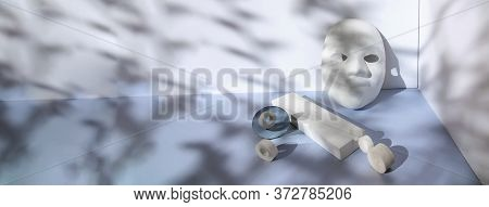 Geometric Composition Of Mask, Round Stones, Mirror, Rectangle. Against A Grey Background Of The Sha