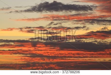 Deep Red Clouds At Sunset Texture With Warm Sky Colors In Background, On Gili Air Island, Lombok, In