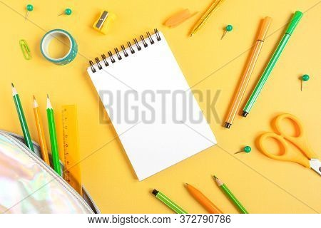 Concept Back To School. School Stationery Flat Lay: Watercolor, Notebook, Pens, Pencils, Sharpener,