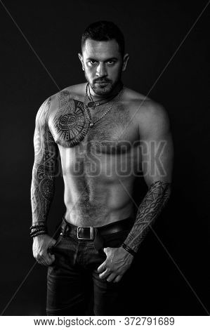 Sport And Fitness. Masculinity. Muscular Torso. Jewelry For Real Men. Bearded Man With Tattooed Tors