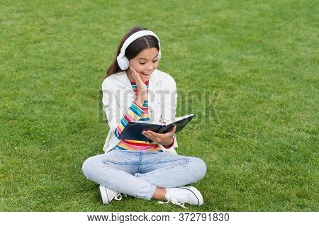 Concept Of Education And Reading. Development Of The Imagination. Cute Girl Read Book. Happy Prescho