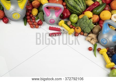 Fitness Concept. Healthy Nutrition: Fruits And Vegetables. Equipment For Fitness Exercises: Weighing