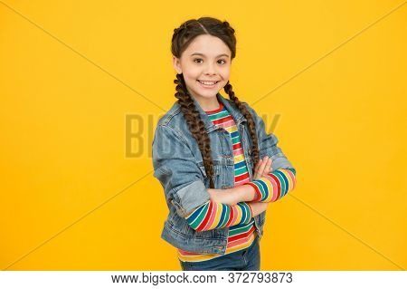 Staying Cool And Fabulous. Happy Girl With Cool Look. Little Child Keep Arms Crossed Yellow Backgrou