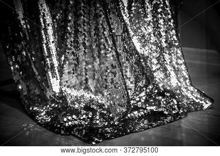 Black And White Photo Of Sparkling Sequins Fabric With Shining Rumpled Surface Looks Like Snake Skin