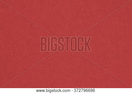 The Surface Of Dark Red Cardboard. Paper Texture With Cellulose Fibers. Saturated Color. Background