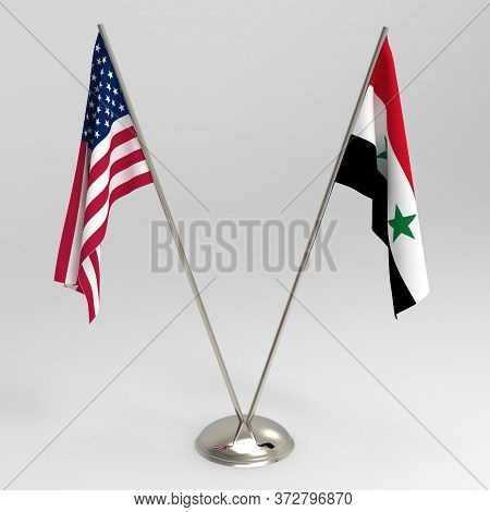 Us Flag And Syria Flag On A Grey Background, Table Flags 3d Render. Relations Between The Usa And Sy