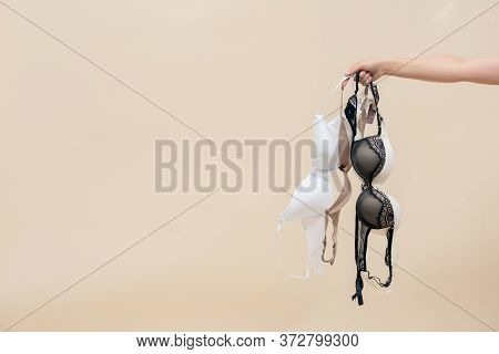 Woman Is Holding A Bra In Her Hand. Brassiere Choice.