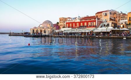 Embankment And Venetian Habour With Turkish Mosque Yiali Tzami Of Chania At Sunset, Crete, Greece, P