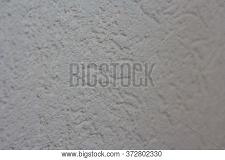 Abstract Light Beige Grainy Background With The Texture Of Coarse-grained New Decorative Plaster. Co
