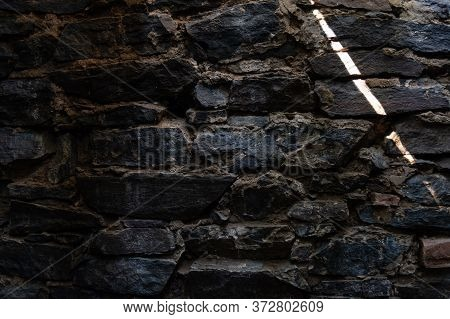 The Wall Of The Old Cellar. Sunbeam In A Dark Cellar. Masonry.