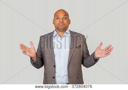 Puzzled Embarrassed, Black African-american Young Man, Shrugging His Shoulders In Frustration With A