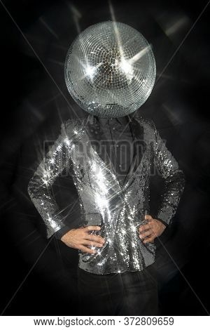 Mr Discoball With A Mirror Bal As A Head In Nightclub Dancing Against A Black Background