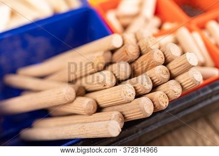 Wooden Dowels Used In Carpentry. Utensils In A Box For Joining Wood.