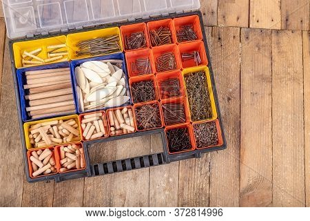 Carpentry Tools On A Wooden Table. Utensils In A Box For Joining Wood.