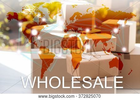 Wholesale Business. World Map And Blurred Parcel Boxes On Background