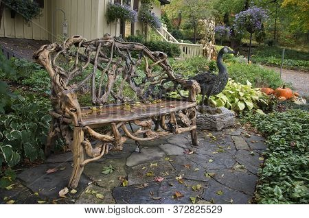 Garden Chair And Front Yard Decoration With Pumpkins.