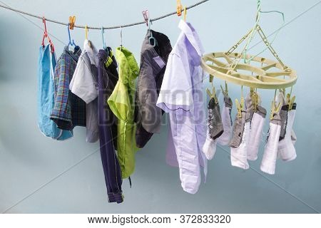 The School Is Open During The Rainy Season. So Must Dry The Clothes In The Shade, May Cause Damp Odo
