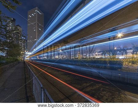 Light Trails Of Traffic In Downtown Of Hong Kong City At Night. Traffic Background