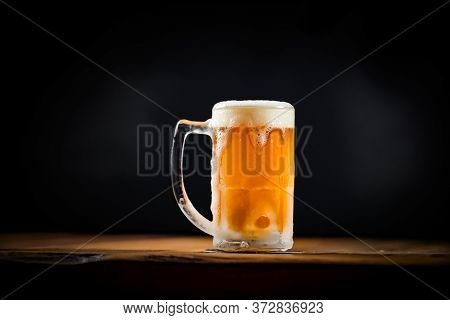 Mug Full Of Chopp, With Chopp Pilsen On A Rustic Table, With Space For Writing