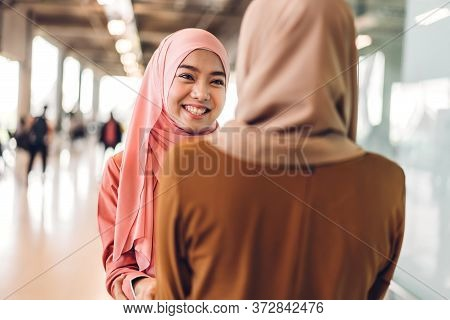 Portrait Of Happy Arabic Two Friend Muslim Woman With Hijab Dress Smiling And Talking Together At St