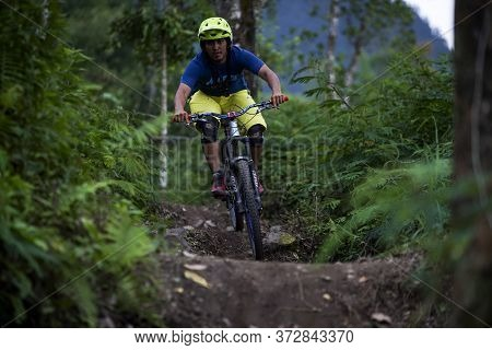Indonesia June 23, 2020 : Professional Biker Is Riding A Mountain Bike Downhill Style