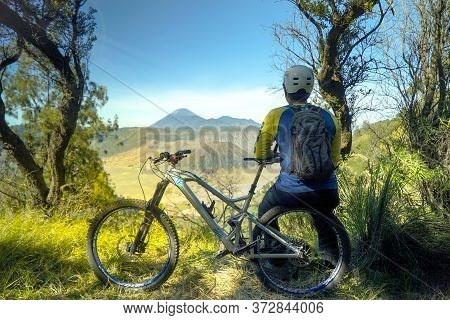 Indonesia June 23, 2020 : Bromo Mt Professional Biker Is Riding A Mountain Bike Downhill Style