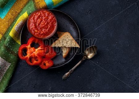 Ajvar Or Pindjur Red Vegetable Spread Or Pepper Paprika And Tomato Mousse In A Bowl In A Black Plate