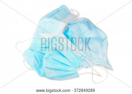Discarded Protectve Face Masks on White Background