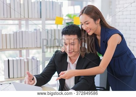 Business Man And Secretary Working Together Using Laptop Computer At Modern Office, Lifestyle Busine