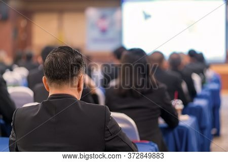 Business Conference And Presentation In Meeting Room, Audience Listens To Speech Of The Lecturer At