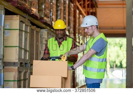 Warehouse Worker Loading Or Unloading Boxes At Warehouse,logistics Concept.