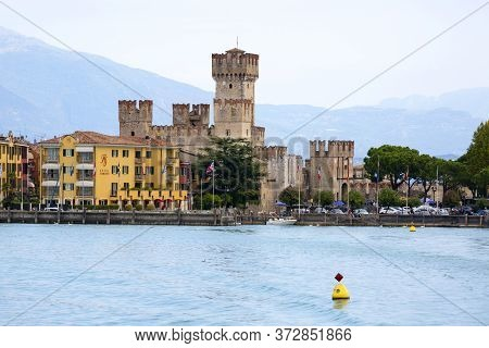 Sirmione, Lake Garda, Italy - September 29, 2018: 13th-century Medieval Stone Scaliger Castle (caste