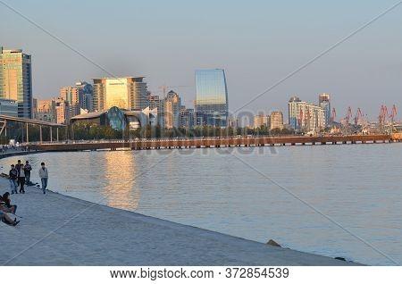 Baky Skyline View From Baku Boulevard The Caspian Sea Embankment . Tall Buildings In Baku. Ship Cran