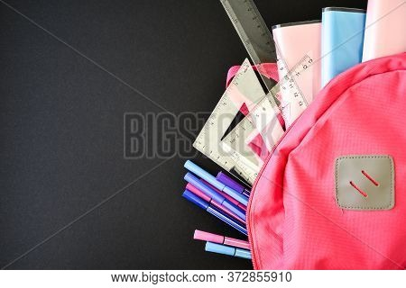 Pink Backpack With School Supplies On A Blackboard Background, Copy Space For Text, Back To School,