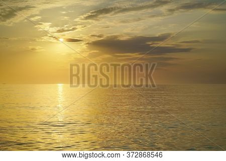 Golden sunset sea background. Abstract light way to the sun. Nature composition.