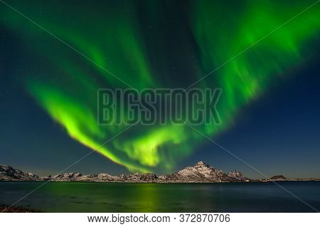 Aurora Borealis, Northern Lights Over Fjord Mountains With Many Stars On The Sky In Lofoten Islands,