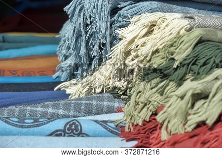 Pile Of Woolen Rugs With Brushes   Close Up