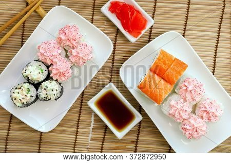 Philadelphia Roll With Cream Cheese, Wrapped With Fresh Salmon Plastics Top View, Lava Roll With Cre