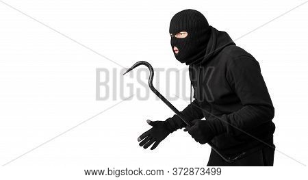Portrait Of Disguised Looter Holding Crowbar And Looking At Copy Space, Isolated On White Studio Wal