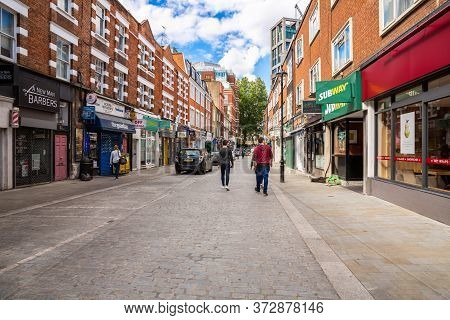 London, Uk - August 8, 2019 - People Walking In Strutton Ground Street In The City Of Westminster.