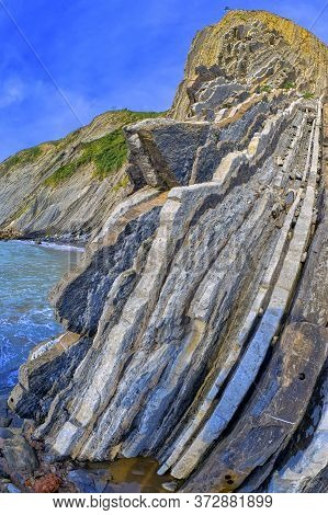 Steeply-tilted Layers Of Flysch, Flysch Cliffs, Basque Steeply-tilted Layers Of Flysch, Flysch Cliff