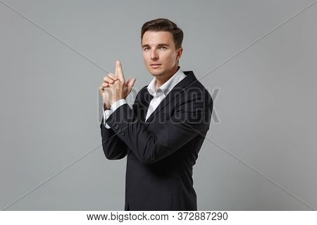 Confident Young Business Man In Classic Black Suit Shirt Posing Isolated On Grey Background Studio P