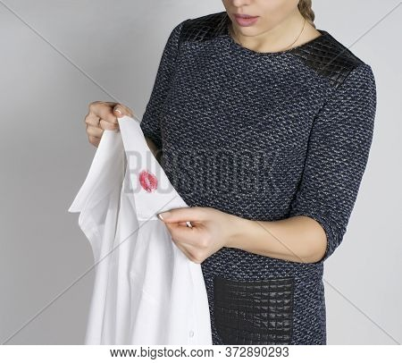 Lipstick On The Collar Of A Men's Shirt. Men's Treason. Interpretation