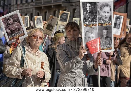 St Petersburg, Russia - May 09, 2015: People Take Part In Immortal Regiment Parade On Nevsky Prospec