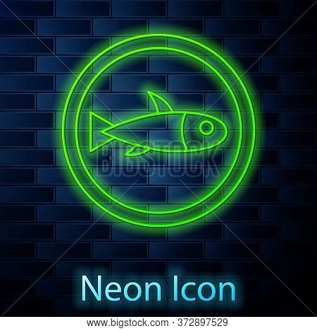 Glowing Neon Line Served Fish On A Plate Icon Isolated On Brick Wall Background. Vector.