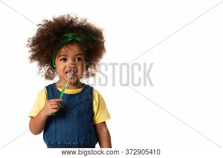 A Little Cute African American Girl Brushing Her Teeth, Isolated Over White Background With Copyspac