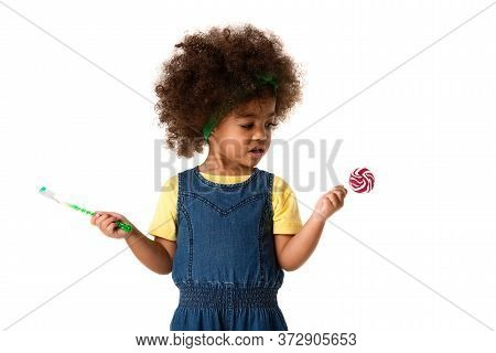 Childhood And People Concept-lovely African American Little Girl With Toothbrush And Sweet Lolipop.