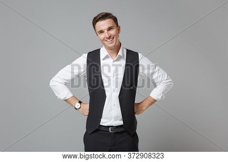 Cheerful Young Business Man In Classic Black Waistcoat Shirt Posing Isolated On Grey Wall Background