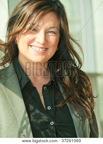 Portrait Of Smileing Busineess Lady In Grey Pantsuit